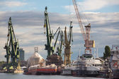Huge ships with cranes in Gdansk Shipyard — Stock Photo