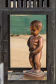 Representation of the Manneken Pis in a box. — Stock Photo