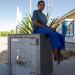 Black woman sitting on a bank safer at the Namibian border in Bo — Стоковая фотография