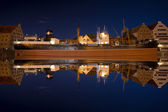 Reflections of the ship Soldek at night in the river Motlawa in — Stock Photo