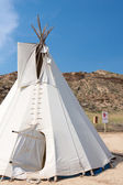 White original American teepee with blue sky in the background — Stock Photo