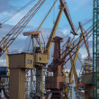 Stockfoto: Industrial cranes in Gdansk shipyard