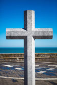 Stone cross in memory of deceased sailors. Lekeitio, Basque  — Stock Photo