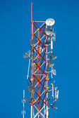 Communication Tower on blue sky background — Stock Photo