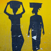 Silhouettes of African women painted on old wall — Stock Photo