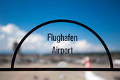 Airport sign on transparent window — Stock Photo
