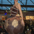 Model walking with chocolate dress during fashion show — Stock Photo #50953959
