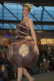 Model walking with chocolate dress during fashion show — Stock Photo