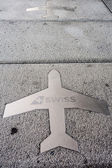 Silhouette of a plane on the floor with the brand Swiss — Stock Photo