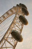 The London Eye with blue cloudy sky in the background — Stock Photo