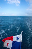The Panama Flag waving with the horizon and the sea — Stock Photo