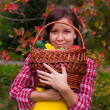 Girl with basket of vegetables — Stock Photo #12106380