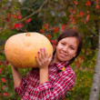 Girl with large pumpkin — Stock Photo
