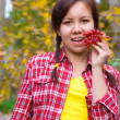 Girl with red berries — Stock Photo