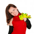 Attractive woman with maple leaves — Stock Photo
