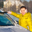 Stock Photo: Girl cleaning car from snow