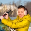Girl cleaning car from snow — Stock Photo