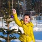 Girl decorating christmas tree — Stock Photo #18184993