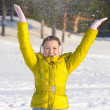 图库照片: Girl throwing snow