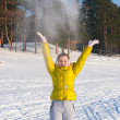 Girl throwing snow — Stock Photo #18185371