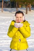 Girl holding snow — Stock Photo