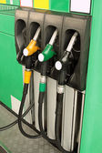 Green gas station with nozzles — Stock Photo