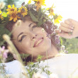 Woman with flowers in hair - Stock Photo