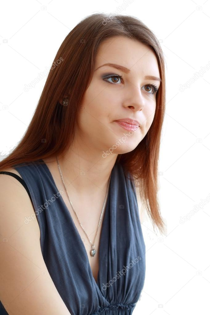 Beautiful and unhappy young woman with dark wavy hair looking into the camera with serious expression on her face. Isolated on white background — Stock Photo #16784153