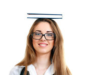 Woman carrying book on her head — Stock Photo