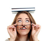 Wearing book on her head — Stock Photo