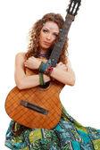 Beautiful Girl holding guitar — Stock Photo