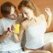 Young couple have breakfast in bed — Foto Stock