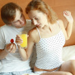 Stock Photo: Young couple have breakfast in bed