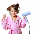Girl with a comb in hair curlers — Stock Photo #17655059