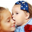 Big sister and little sister kissing — Stock Photo