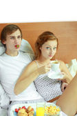 Young couple have breakfast in bed — Stock Photo