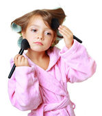 Beautiful girl with hair curlers — Stock Photo