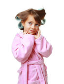 Girl with a comb in hair curlers — Stock Photo