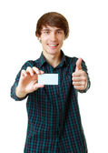 Young smiling man holding blank white card — Stockfoto