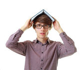 Student with open book on the head — Stock Photo