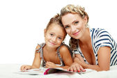 Mother and daughter reading — Stock Photo