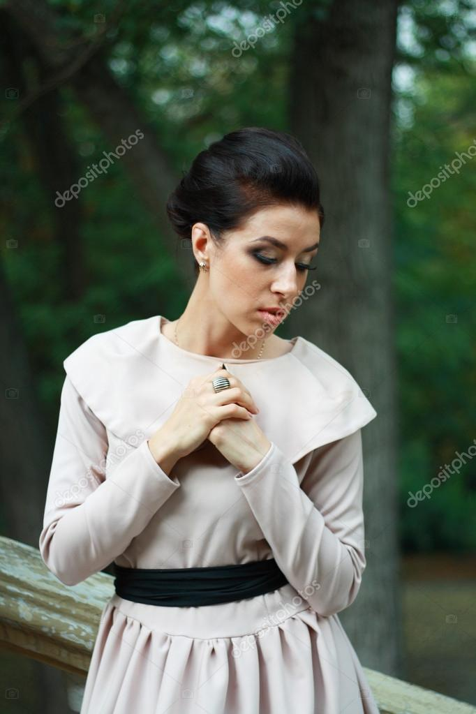 Thoughtful Young lady weared in old fashion dress outdoor — Stock Photo #17650811