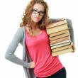 Woman in glasses holding books — Stock Photo #17661127