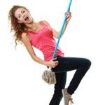 Woman having fun by playing air guitar — Stock Photo