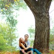 Young couple in autumn park — Stock Photo #17661461