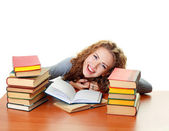 Student girl with books in classroom — Stock Photo