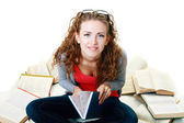 Student girl sitting and meditating with books — Stock Photo