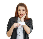 Woman holds out a business card — Stock Photo