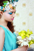 Girl with stylish makeup and flowers — Stock Photo