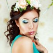 Stock Photo: Girl with stylish makeup and flowers